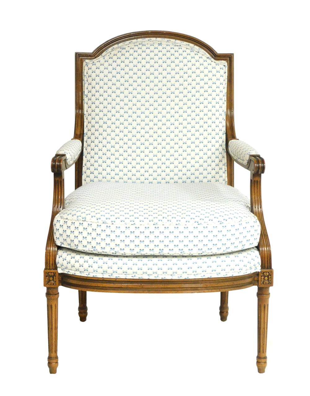 French style open armchair by Baker Furniture, carved frame, blue and white upholstery to shaped back, manchettes, seat and removabl...
