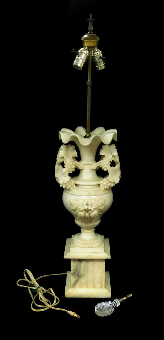 Alabaster lamp with carved grape decoration, late 19th/ 20th C., white with grey veining, urn form on pedestal base with ruffled rim...