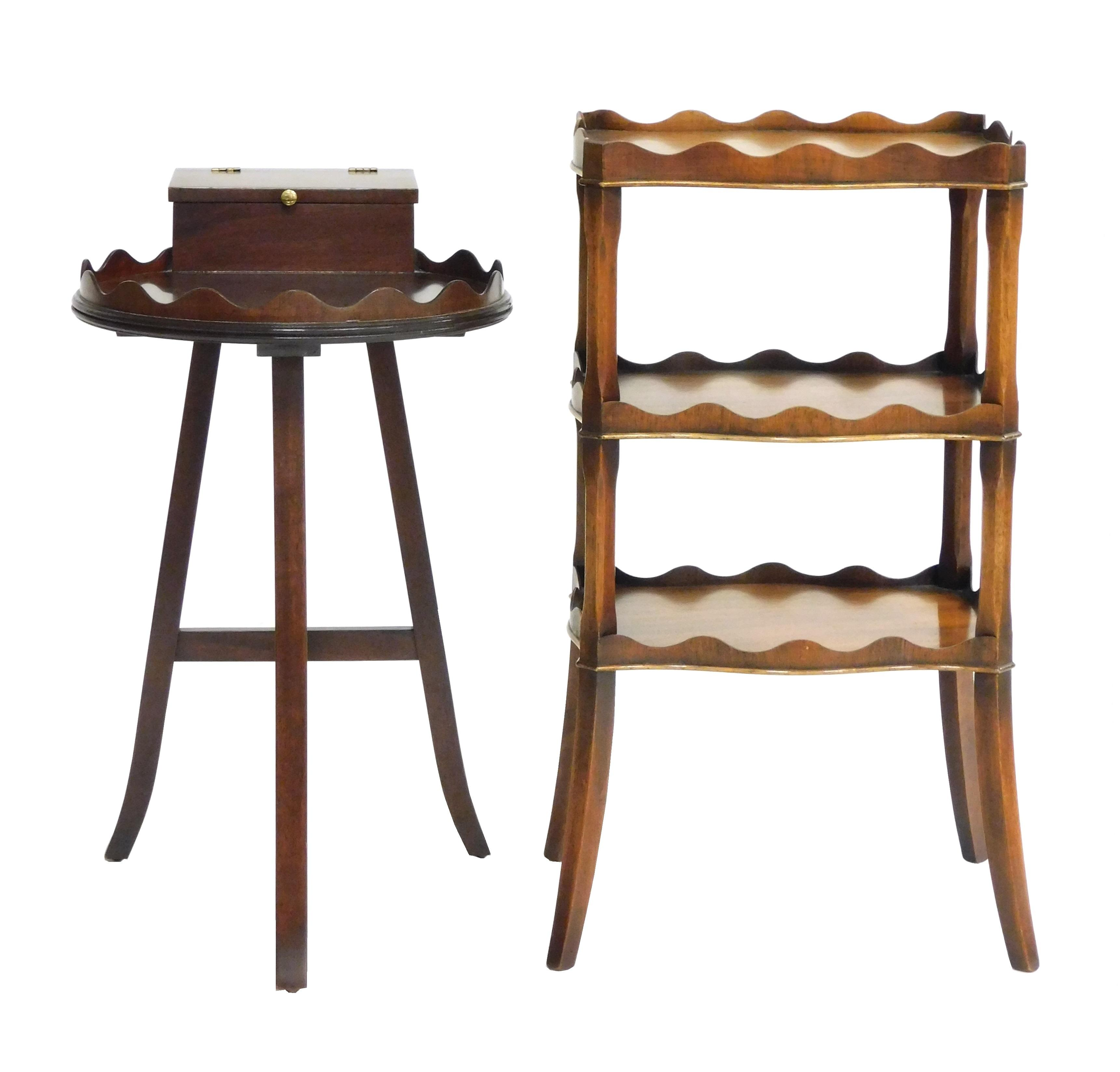 """Two small mahogany stands: one rectangular three tier with raised scalloped edge, some toning, 26 1/2"""" h. x 14"""" w. x 10 1/2"""" d.; sec..."""