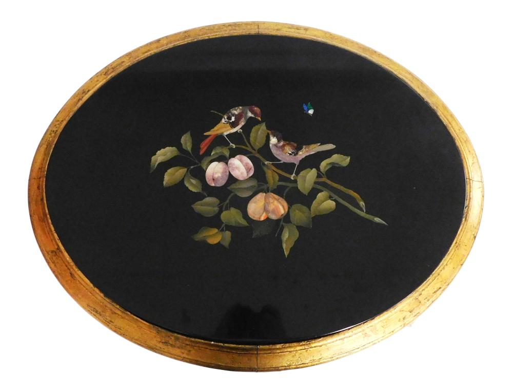Pietra dura oval top table, bird and fruit motif on black stone ground, gilded wooden carved stand resting on four saber legs with f...