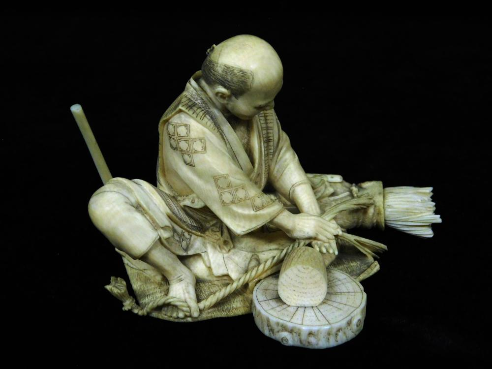 ASIAN: Finely carved ivory figure of a man making rope, Japanese, 19th/20th C., wear consistent with age and use including checking,...