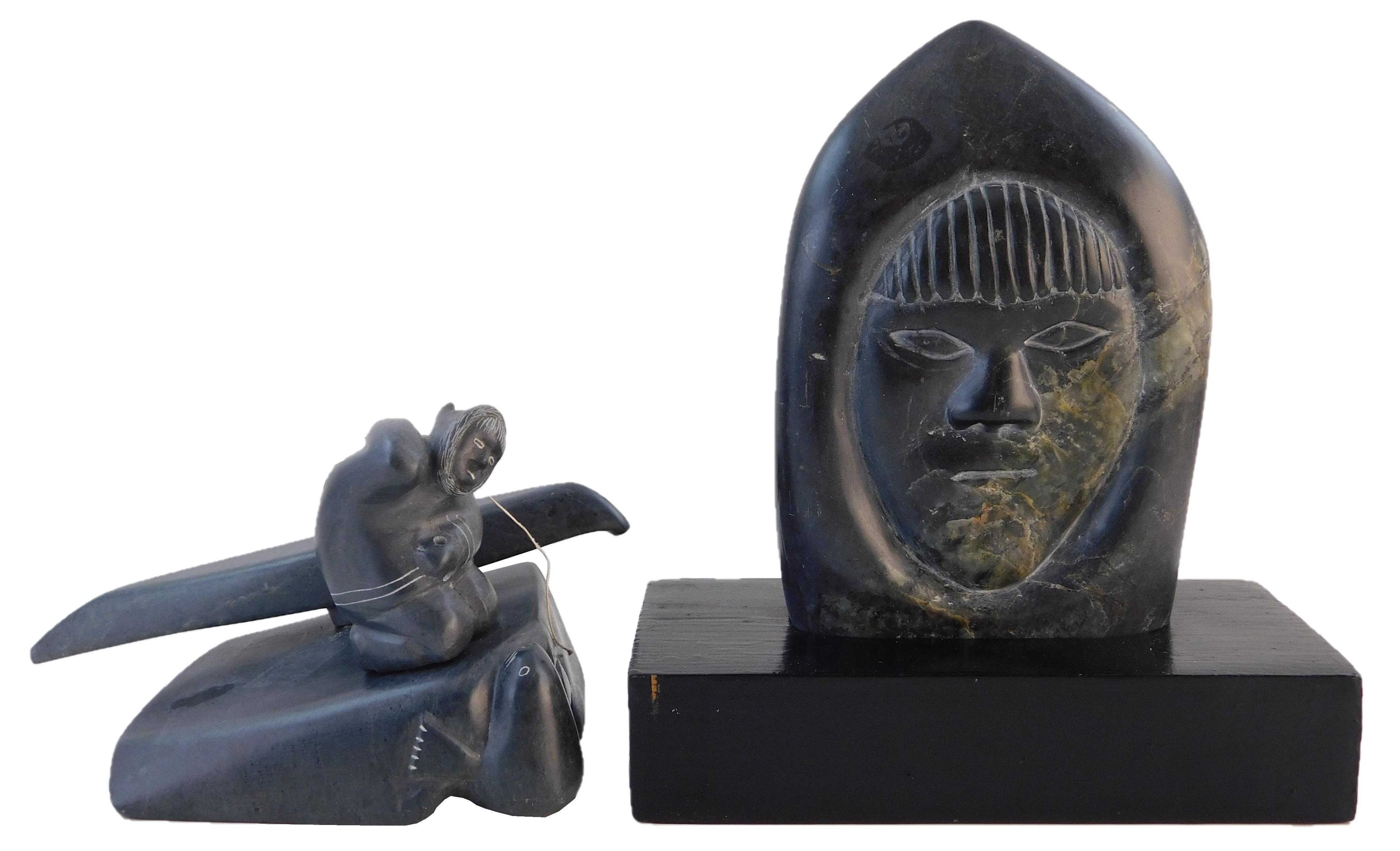 Inuit carved stone figures, 20th C., two pieces, including: group sculpture of kneeling hunter with removable kayak over seal, signe...