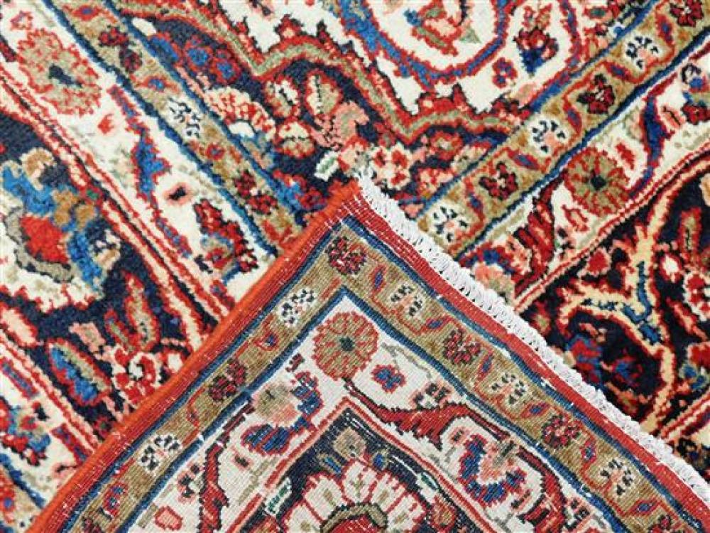 """RUG: Persian Kazvin, 10' x 7' 3"""", 100% wool on cotton, blue central medallion on ruby field, navy major border with ivory guard bord."""