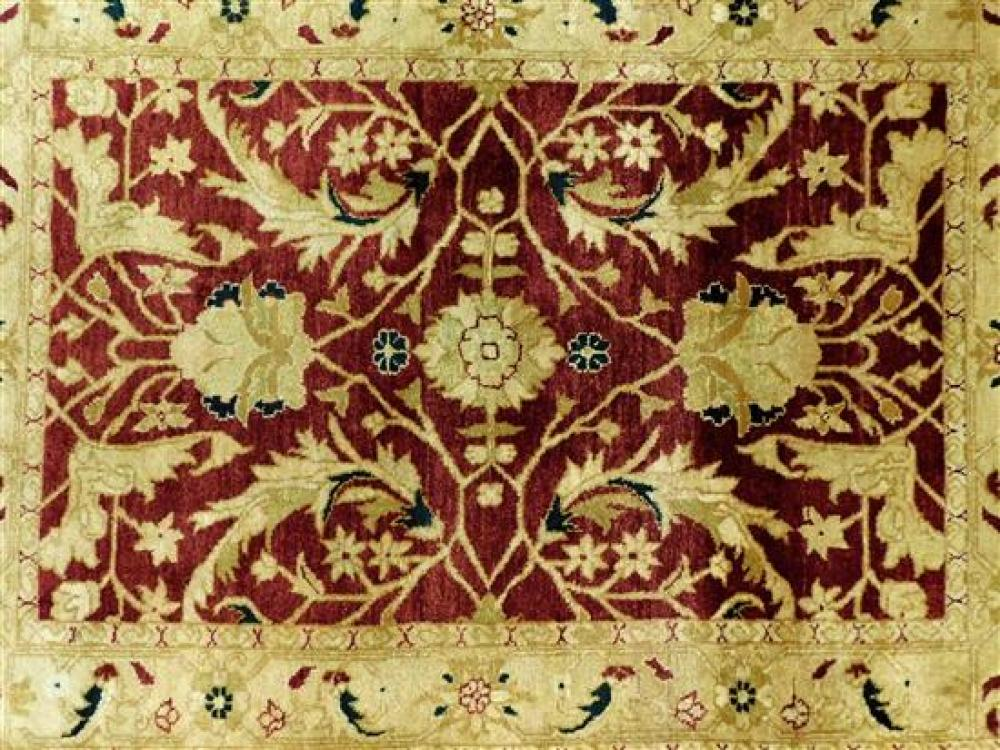 "RUG: Indo Agra, 4' x 5'9"", hand-knotted, 100% wool on cotton, red and gold scrolling vine design with accents of forest green, light."