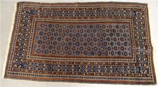 Antique Russian scatter rug, with indigo blue field and brown and cream accents, containing reciprocal, rosette and meandering vine....