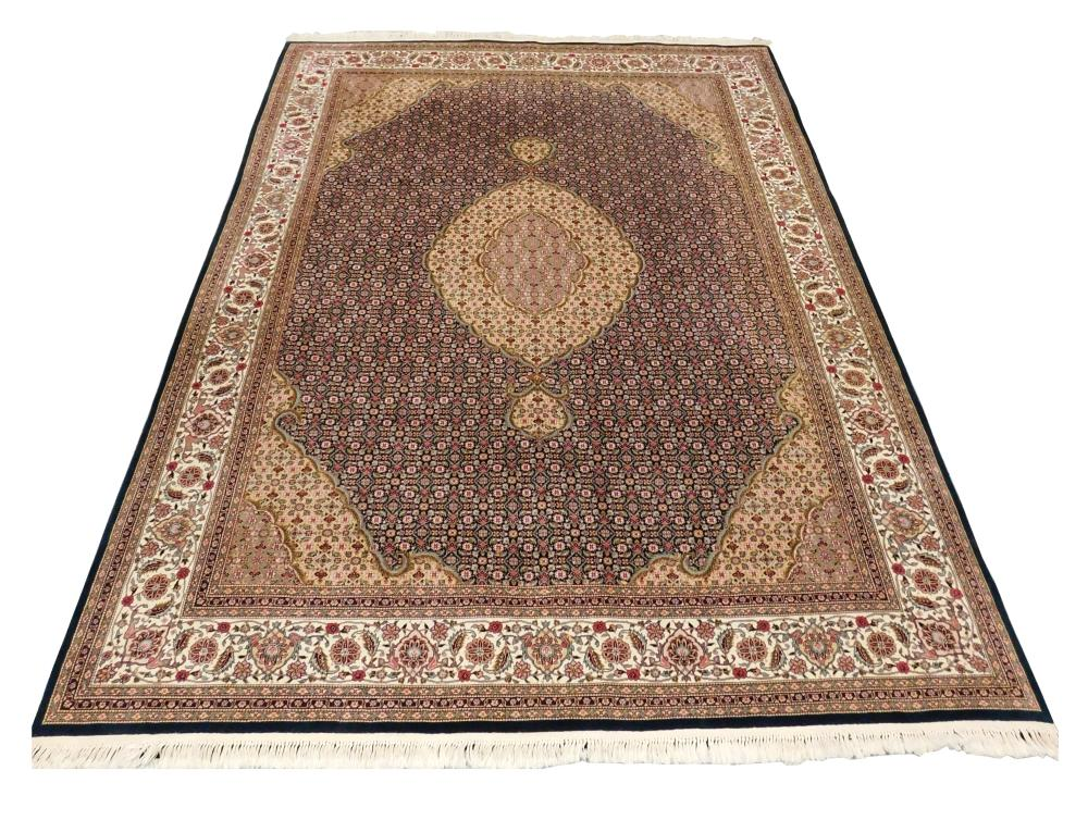 """RUG: Modern Persian style, 12' 6"""" x 9' 4"""", wool on cotton, classic Feraghan design with central ivory medallion on deep forest green."""