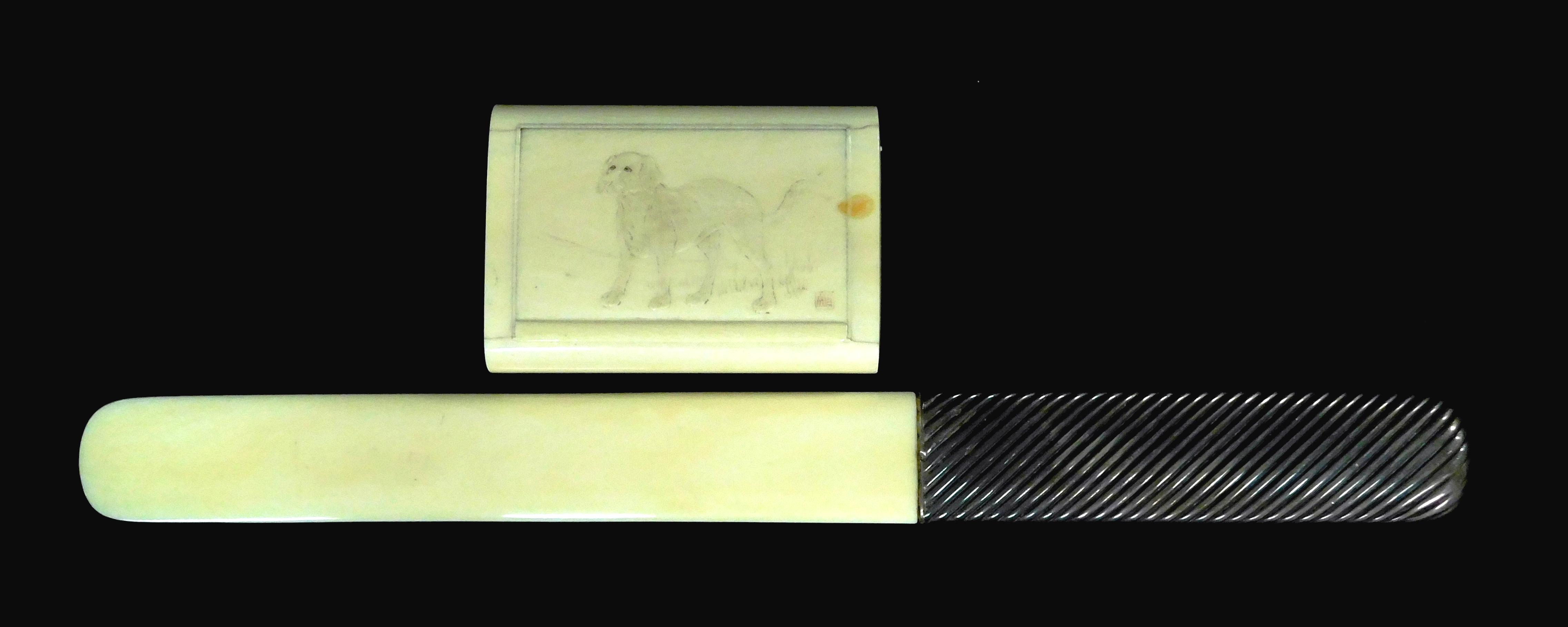 ASIAN: Ivory, two pieces: hinged lid box, Japanese, 19th/20th C., with stained carving of a dog in low relief, signed, wear/loss to...