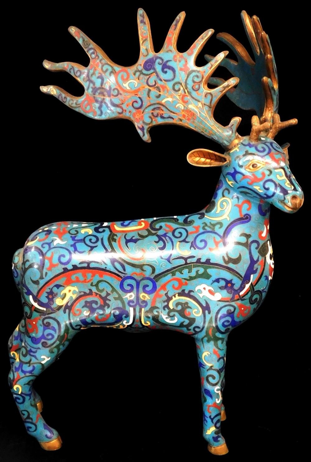 ASIAN: Pair of Chinese cloisonne stags, probably 20th C., polychrome scrolling foliate decoration on blue ground, wear consistent wi...