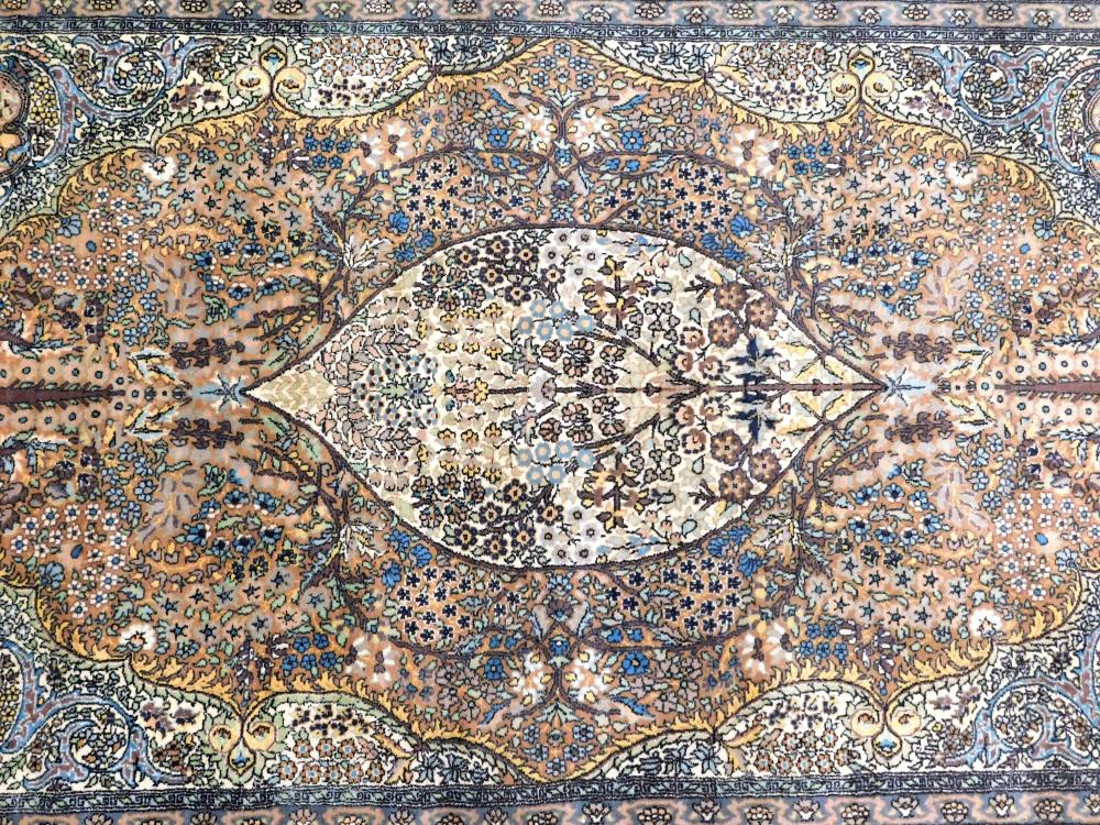 """RUG: Modern Persian style, 82"""" x 55"""", wool on cotton, tree of life design, light blue, tan, overall good condition."""