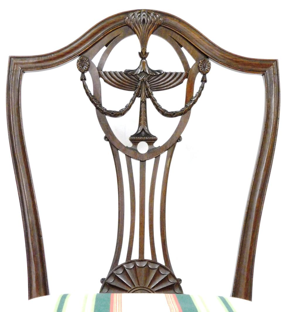 Hepplewhite mahogany shield-back side chair, Massachusetts, c.1790, serpentine molded crest rail with an intricately carved swag and...