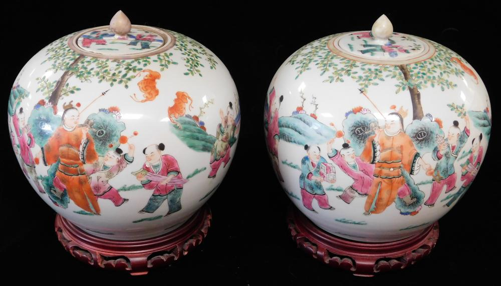 ASIAN: Pair of Chinese famille rose porcelain covered jars, 19th/20th C., bulbous form decorated with figures in a landscape, four c...