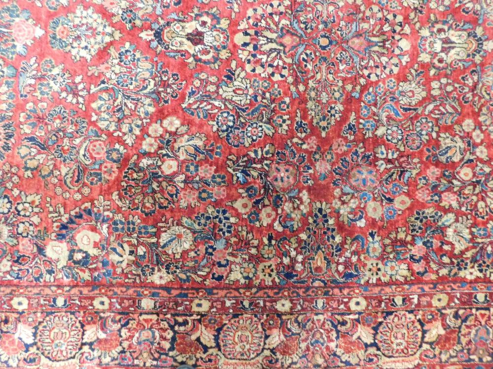 """RUG: Antique Persian painted Sarouk, 11' 8"""" x 9', allover foliate design on red field, accents of navy blue, royal blue, tan, pink,.."""