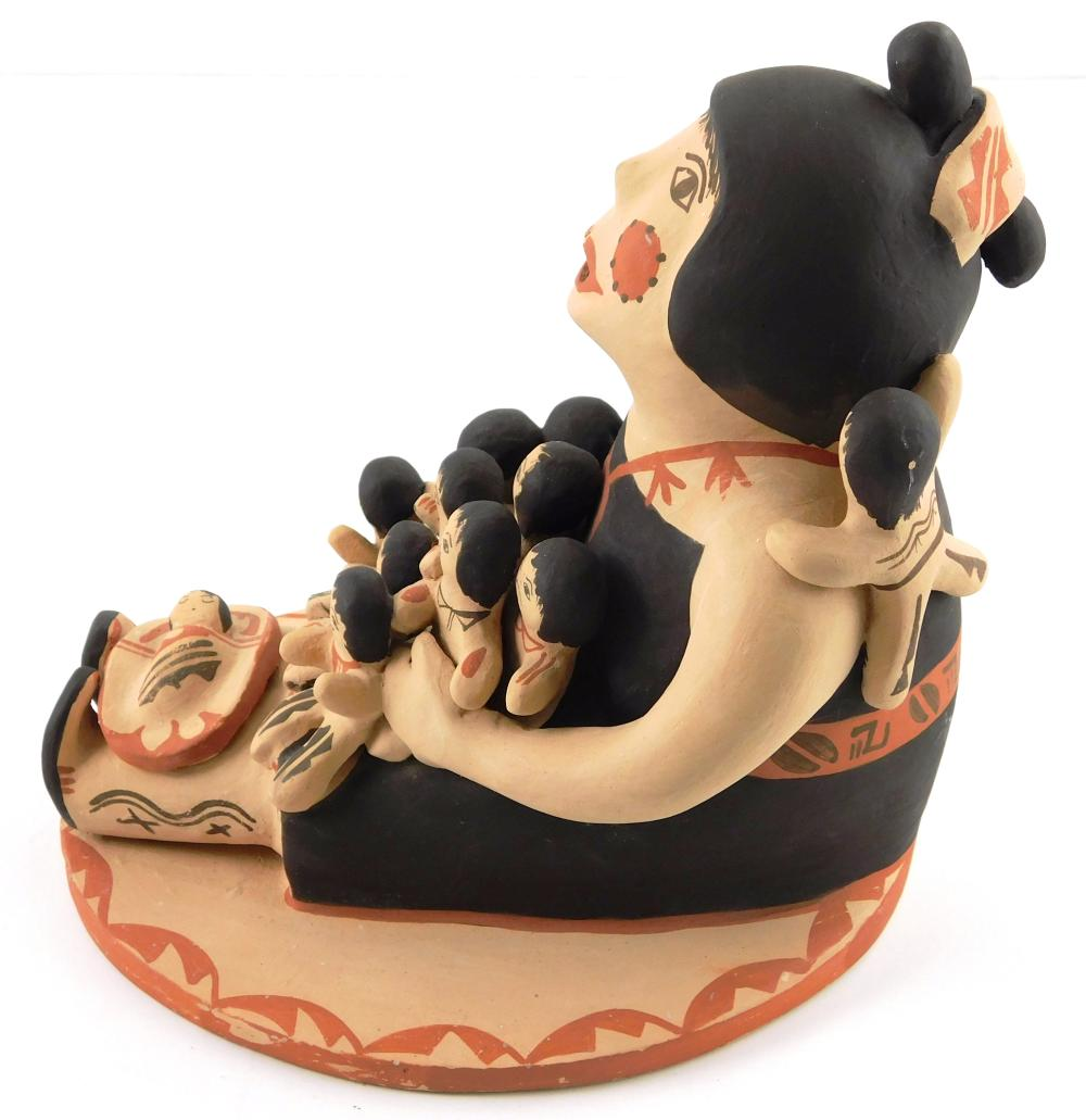 Jemez Pottery storyteller figure by Emily Fragua-Tsosie (American, b. 1951), depicts seated woman with open mouth surrounded by twel...