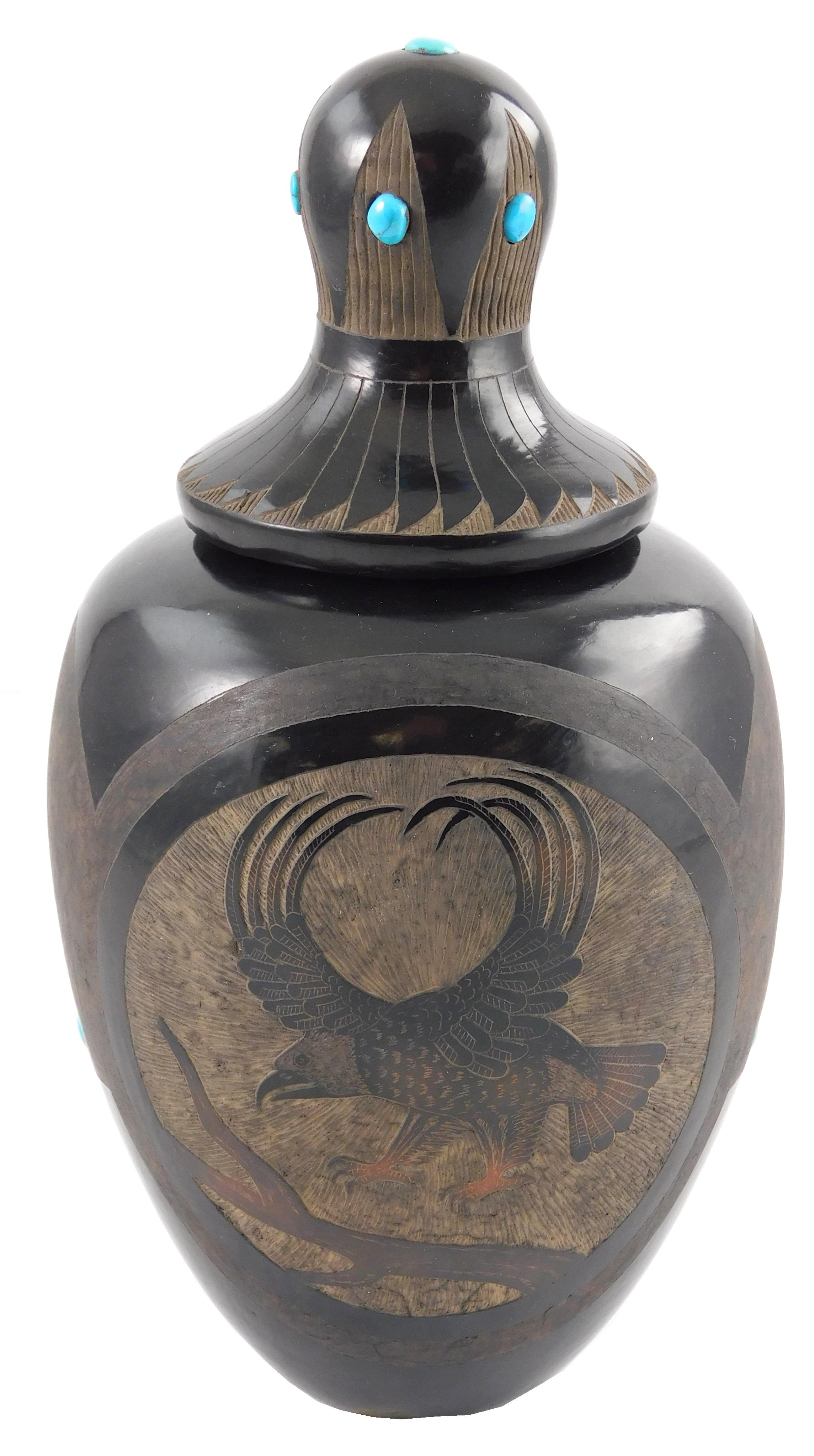 Santa Clara pottery by Corn Moquino (1929 - 2016), sgraffito jar with mirror black glaze and carved eagle decoration to both sides,...