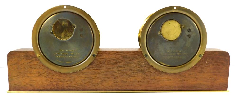 Seth Thomas brass cased ship's clock and barometer, c. 1960-70s, on wooden Helmsman base, model 040687, silver colored dials, clock...