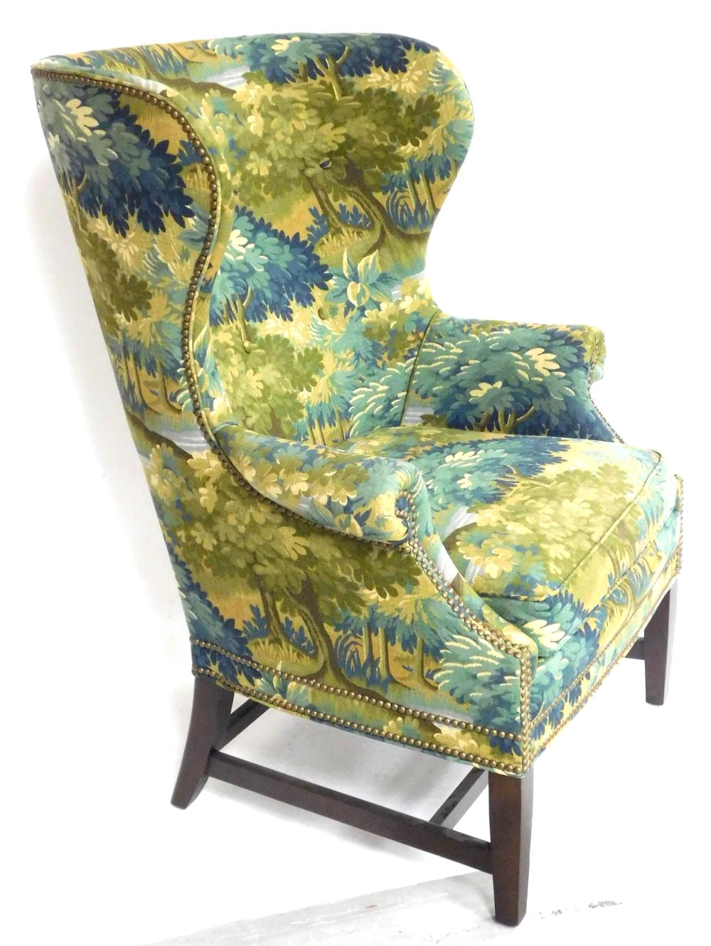 Wing chair by Wesley Hall, Hickory, N.C., late 20th C., blue, green and tan landscape upholstery, barrel back with tufted buttons, r...