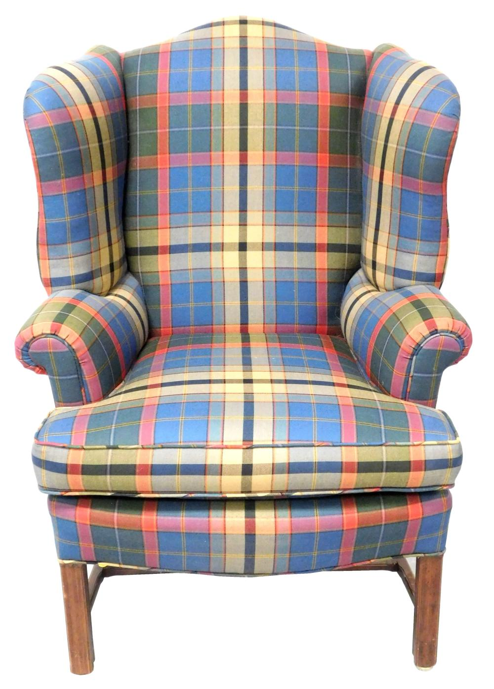 "Chippendale style wing chair with plaid upholstery of red, green, blue and yellow, straight molded front legs and ""H"" form stretcher..."