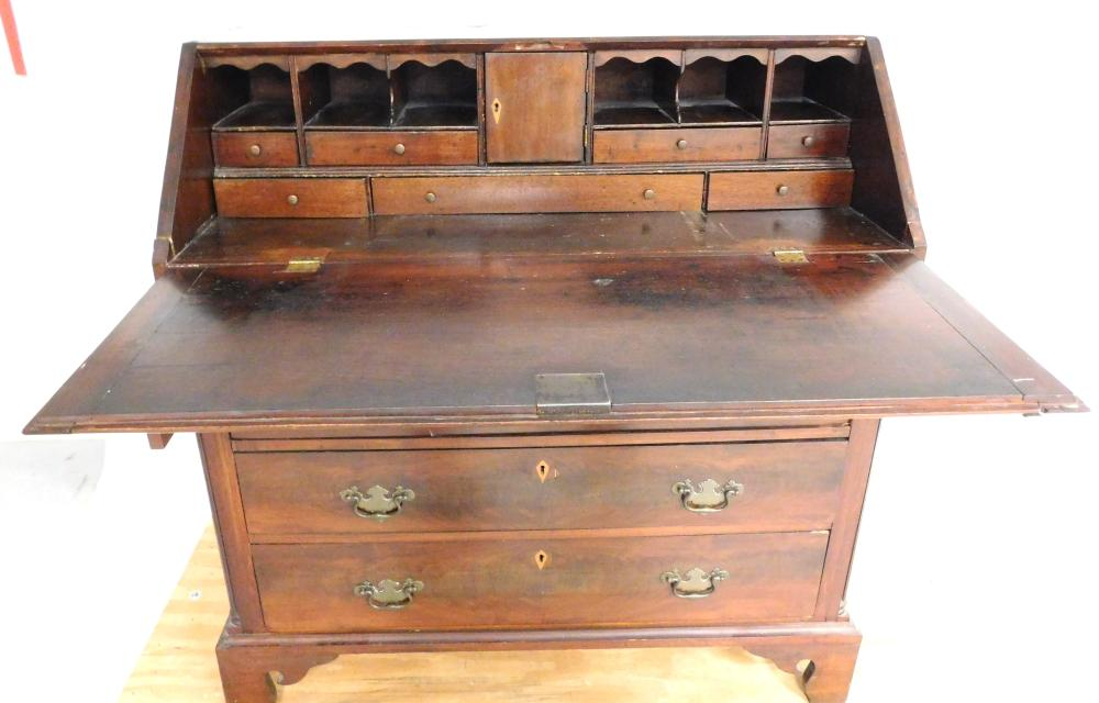 American 19th C. slant lid desk, interior with six pigeon holes and piecrust valance over seven short drawers of varying length, pro...