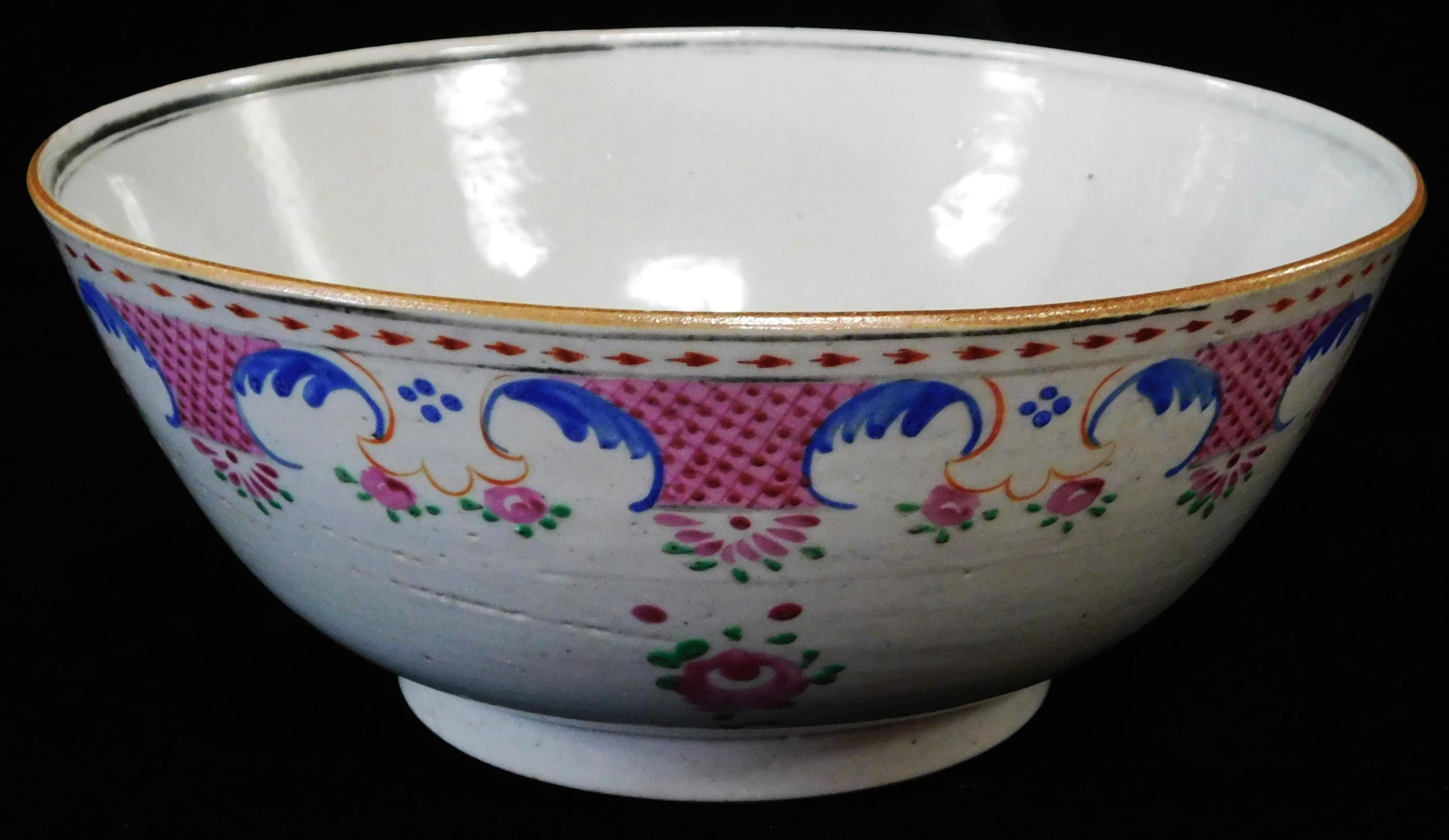 ASIAN: Chinese Export porcelain bowl, late 18th/early 19th C., famille rose floral decoration, wear consistent with age and use, 8 ¾...