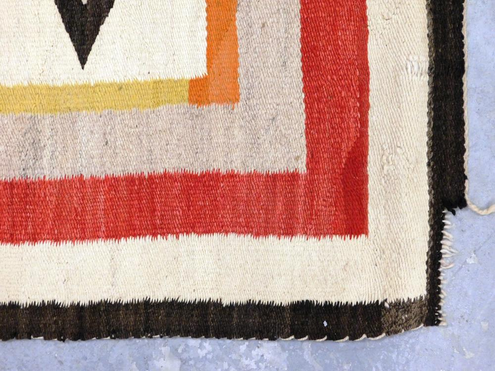 "RUG: Native American Navajo rug, 5' 4"" x 3' 3"", wool on wool, traditional design with cream, red, espresso, and yellow, recently cle."