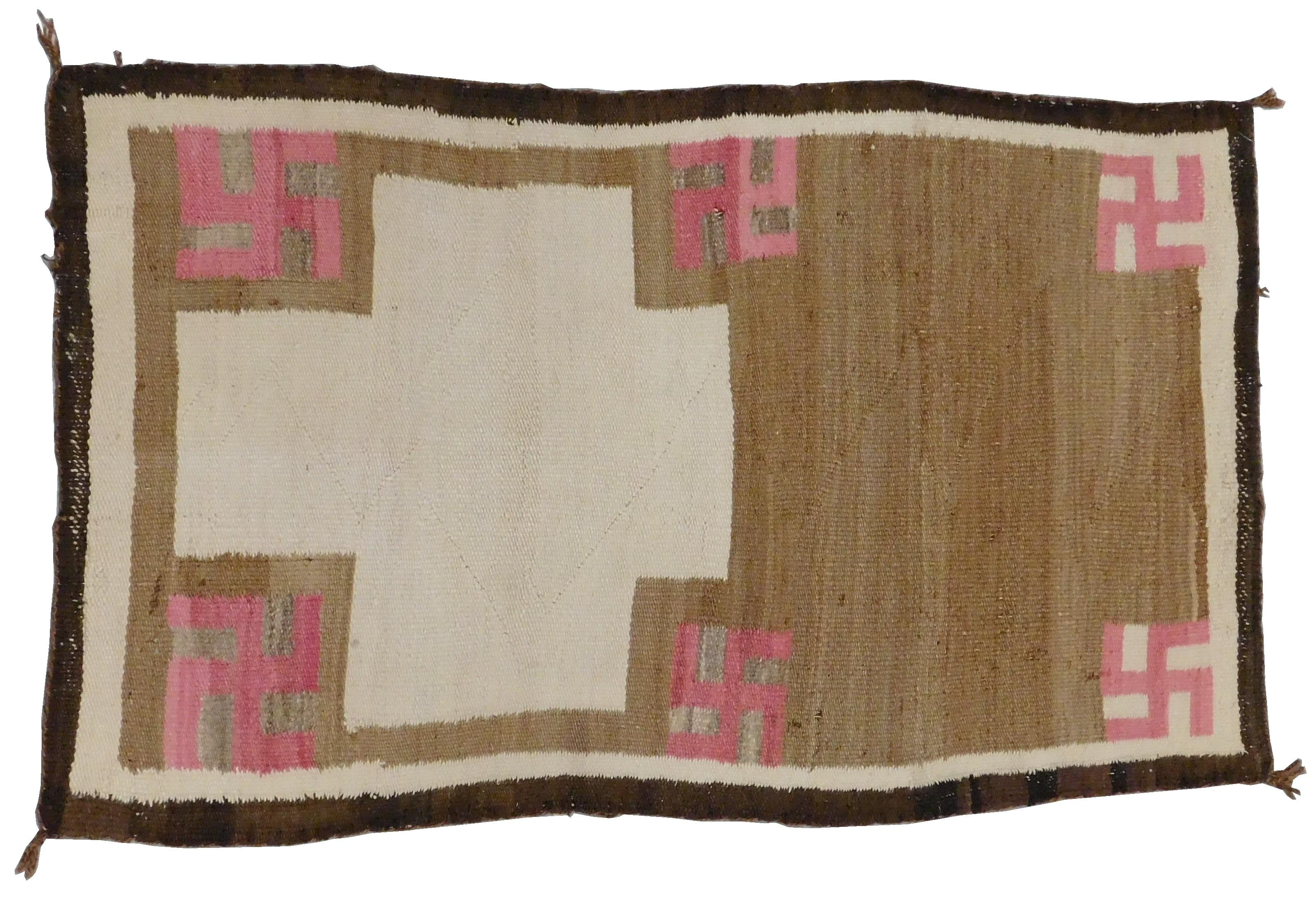 """RUG: Native American Navajo rug, 4' 5"""" x 2' 6"""", wool on wool, off-centered cross design surrounded by rose colored whirling log symb."""