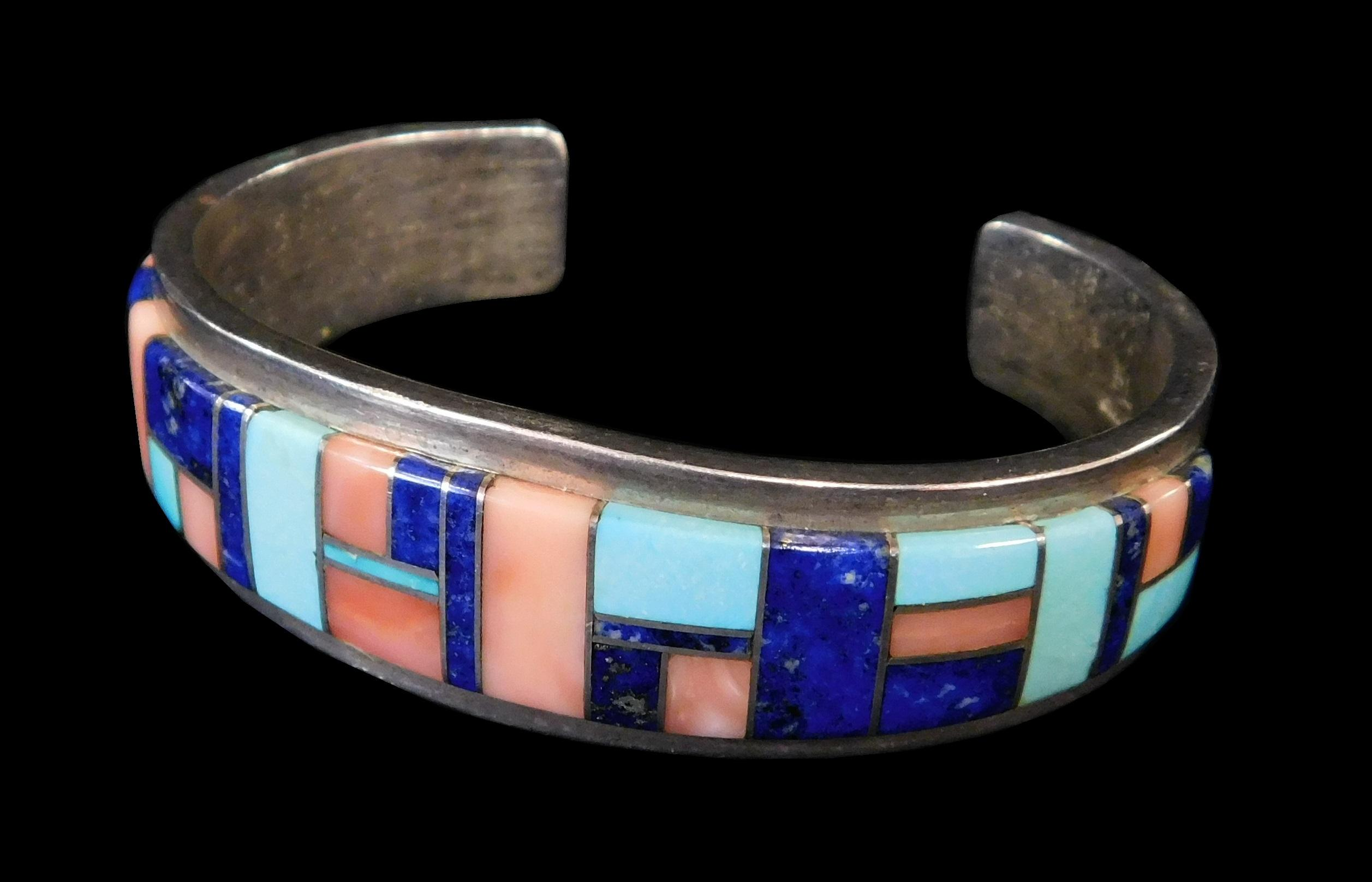 "Native American sterling cuff bracelet with raised channel of inset semi-precious stones, hallmarked ""B.L."" to interior, late 20th/..."