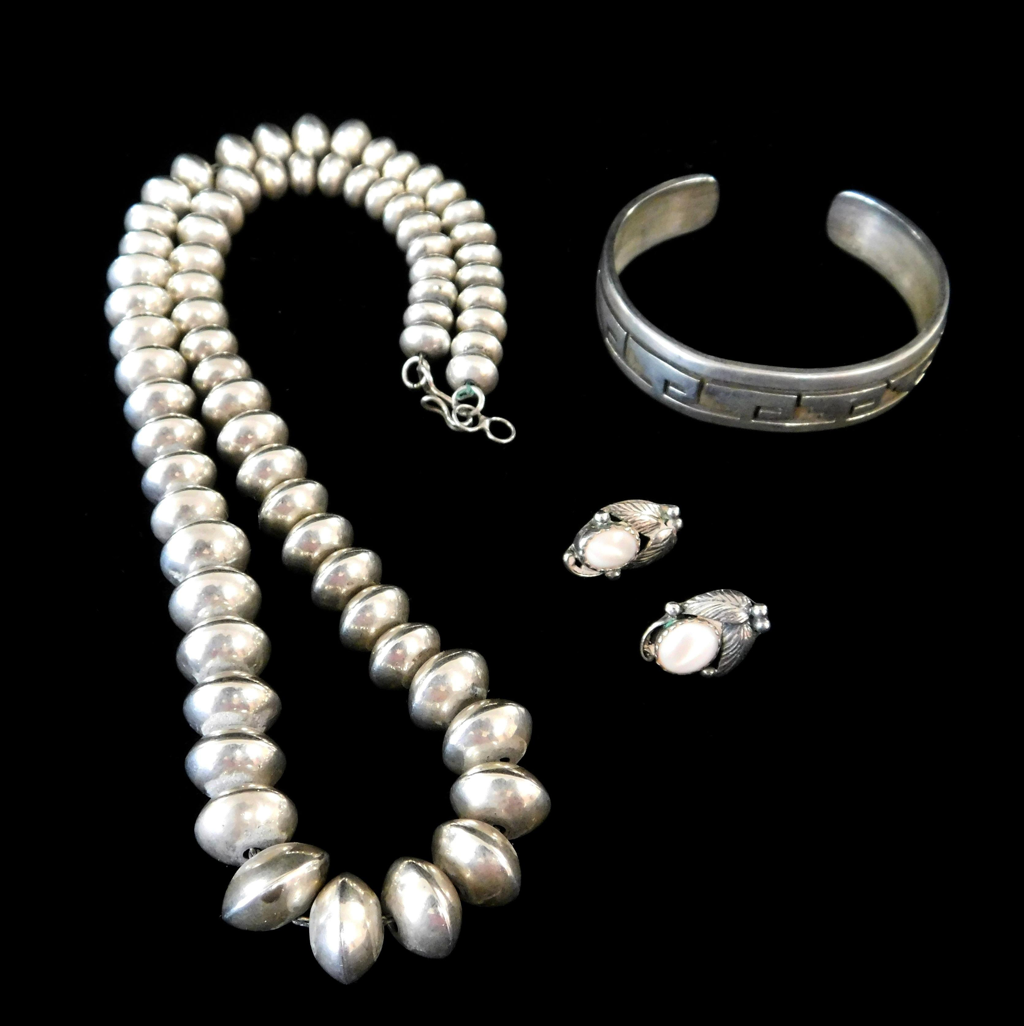 Native American silver jewelry, three pieces, cuff, earrings and beaded necklace, details include: Hopi cuff with incised step desig...
