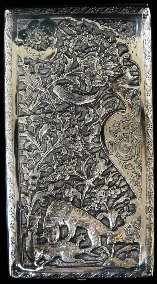 SILVER: Cigarette case with Persian repousse design with lion and stag, oblong form, tested silver, indeciphable hallmarks to exteri...