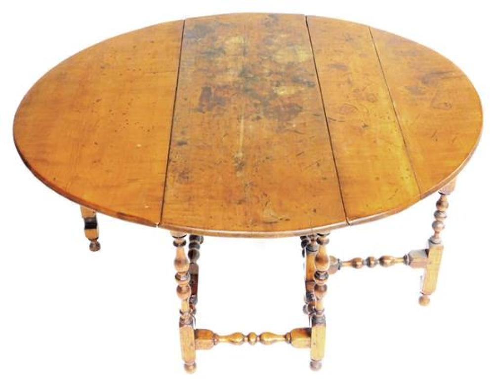 Figured maple gate leg table, New England, c. 1740, two demi-lune leaves over vasiform and ring turned base with one frieze drawer,...