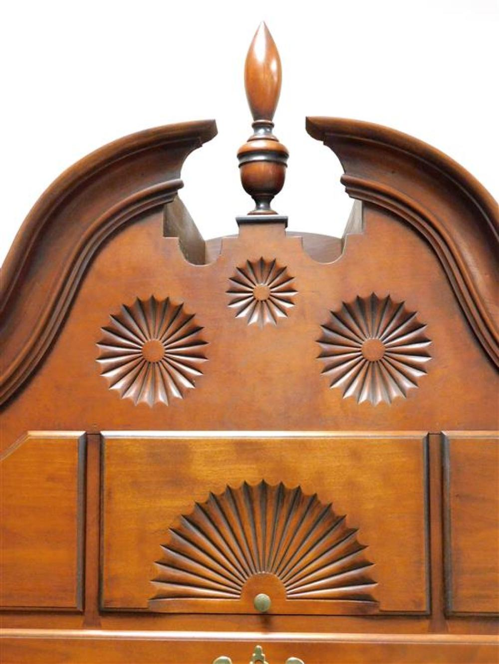 Eldred Wheeler bonnet top high chest, 20th C. reproduction, in two parts, broken arch bonnet top with three finials, eleven drawers...