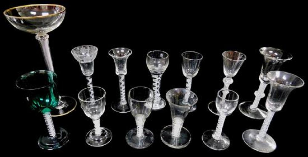 GLASS: Thirteen blown mostly wine glasses with internally decorated stems, European, 18th - 20th C., various sizes and forms, four w...