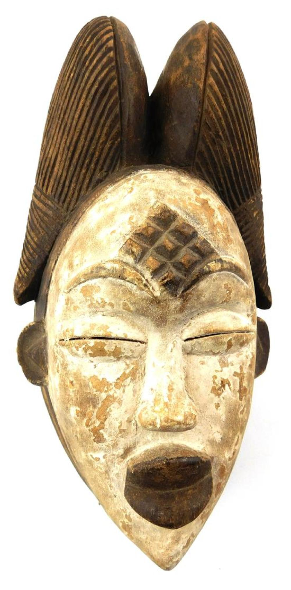 TRIBAL: Three Punu style masks, 20th C., carved wood with painted finish, all with double-lobed coif, carved geometric decoration to...