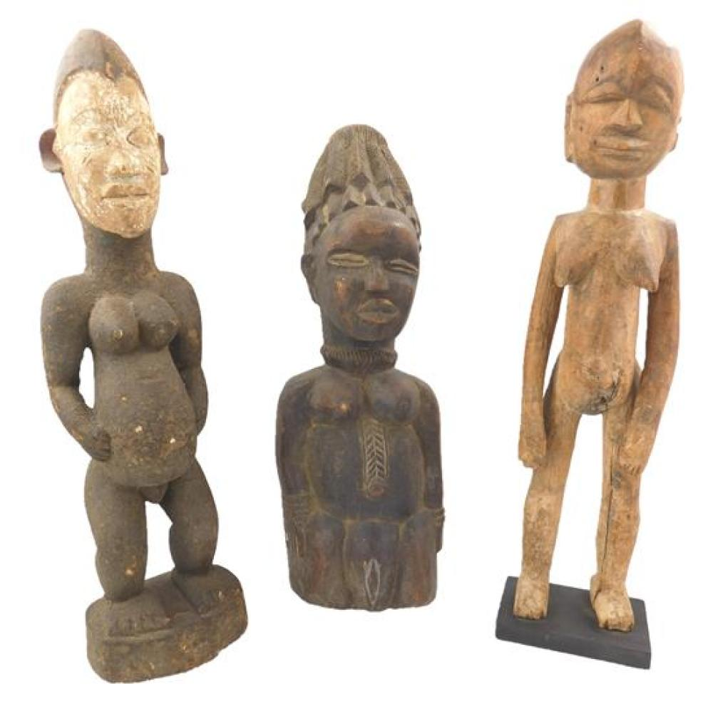 TRIBAL: Three carved figures, one Lobi type, one Dan type and one non-identifiable, 20th C., African, carved wood, details include:...