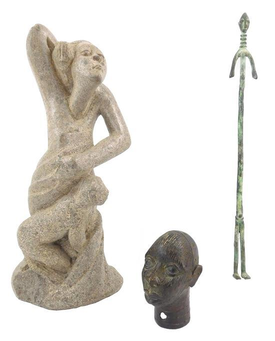 "TRIBAL: Three figural sculptures, 20th C., one stone and two metal, details include: carved stone figure with animal, monogrammed ""C..."