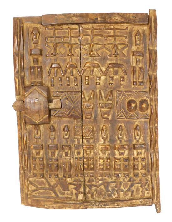 TRIBAL: Dogon type grainery door, 20th C., African, assembled carved wood panels and articulated lock, ancestral and animal carved d...