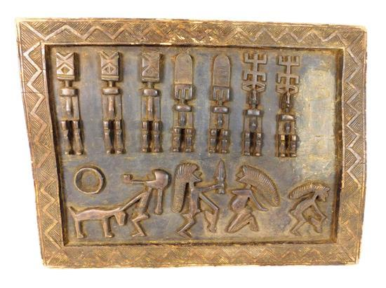TRIBAL: African carved architectural panel, 20th C., depicts ancestral figures and animals, carved zig-zag molded border, wear consi...