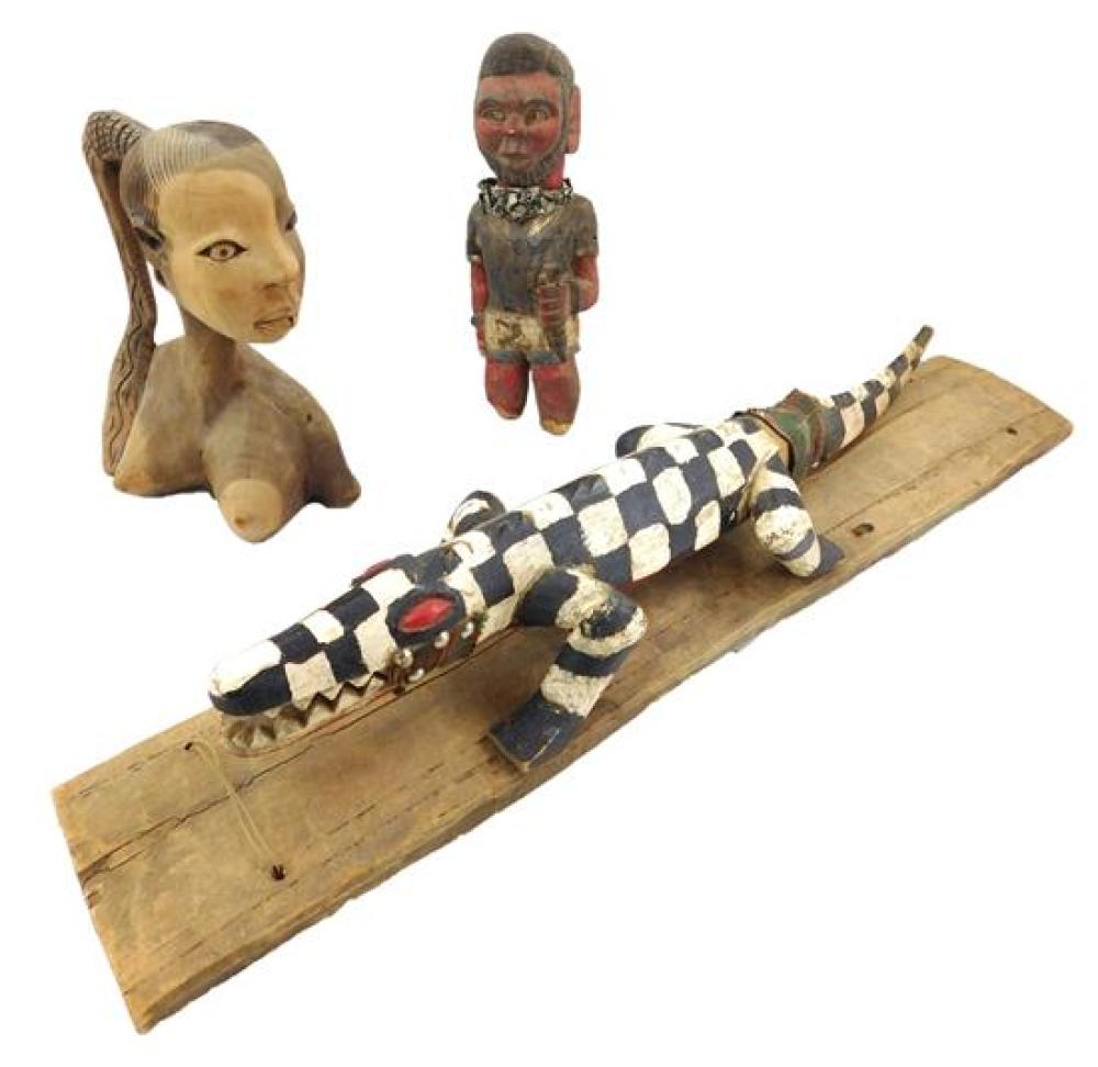 TRIBAL: Three African carved wood items made for the tourist trade, 20th C., including: shortened male Colonial figure with red, blu...