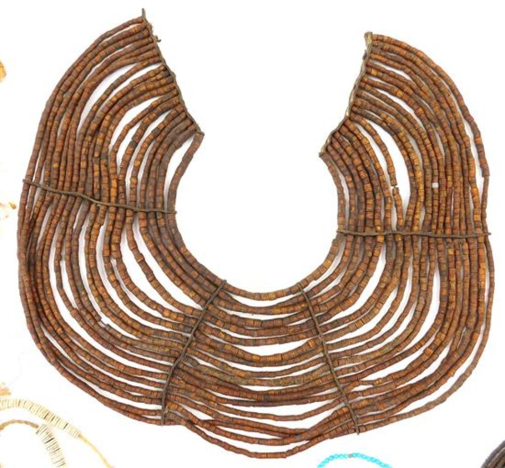 TRIBAL: Nine African type beaded necklaces, 20th C., some in disrepair, details include: largest a collar necklace with eighteen row...