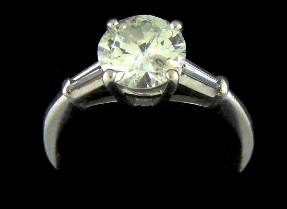 """JEWELRY: Platinum and diamond engagement ring, setting: stamped and tested """"10% IRID PLAT"""", platinum, four prong crown in center, to..."""