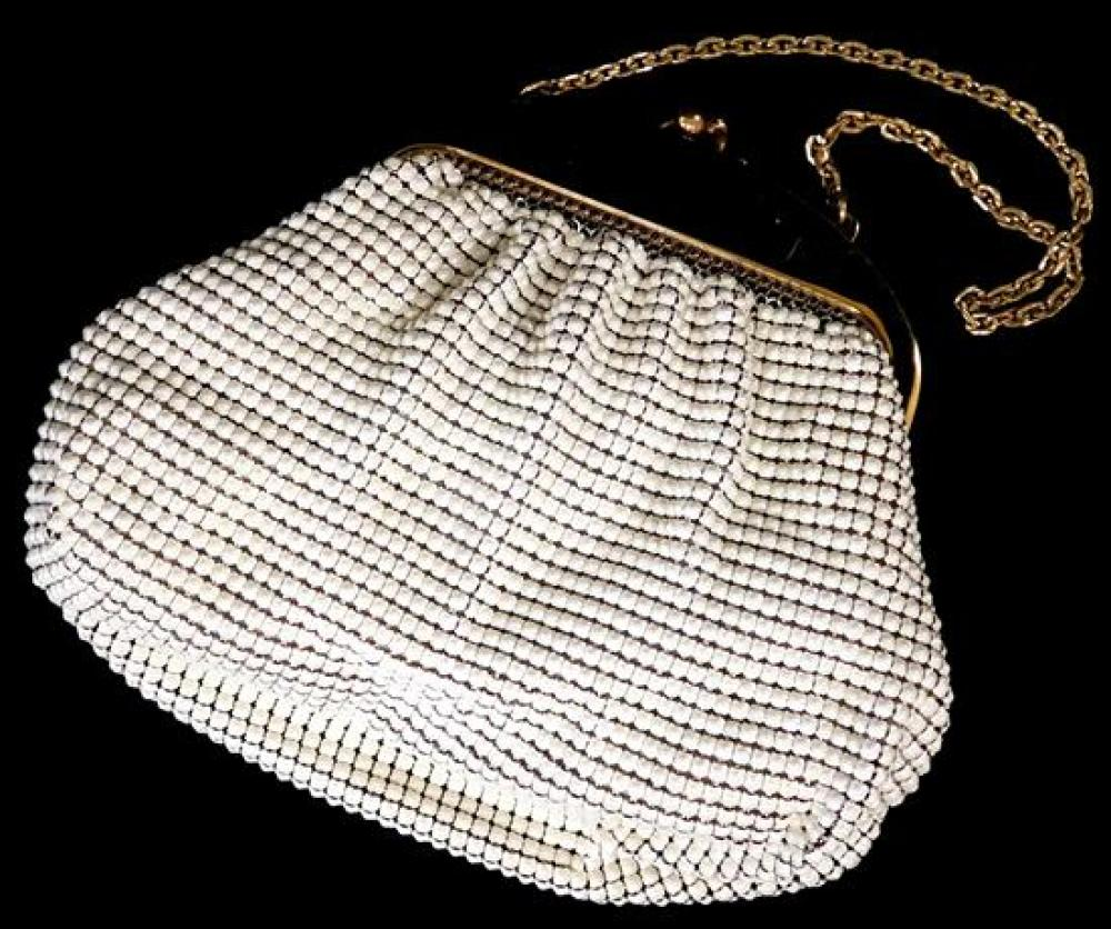 Three small metal purses and one large locket, including Whiting & Davis mesh bag with off-white pearlescent finish to mesh, gold-to...