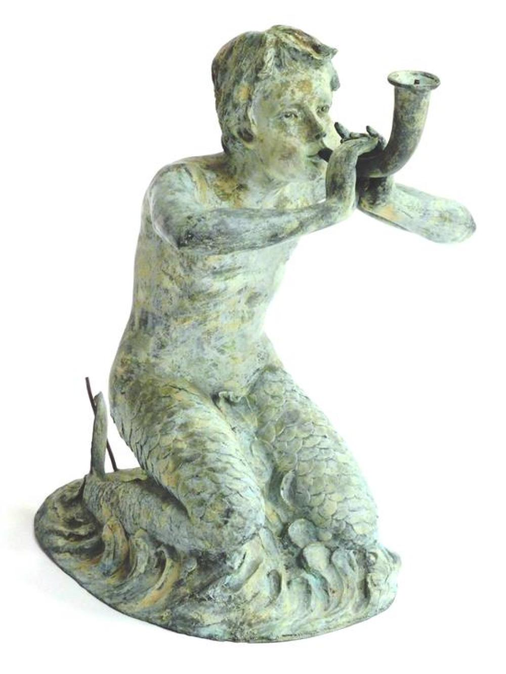 Young boy siren garden sculpture fountain, metal, with two tails kneeling in breaking waves, he blows a horn which is where copper t...