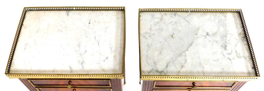Pair of Louis XVI style mahogany three drawer stands, white and grey variegated marble top with pierced brass gallery, each drawer w...