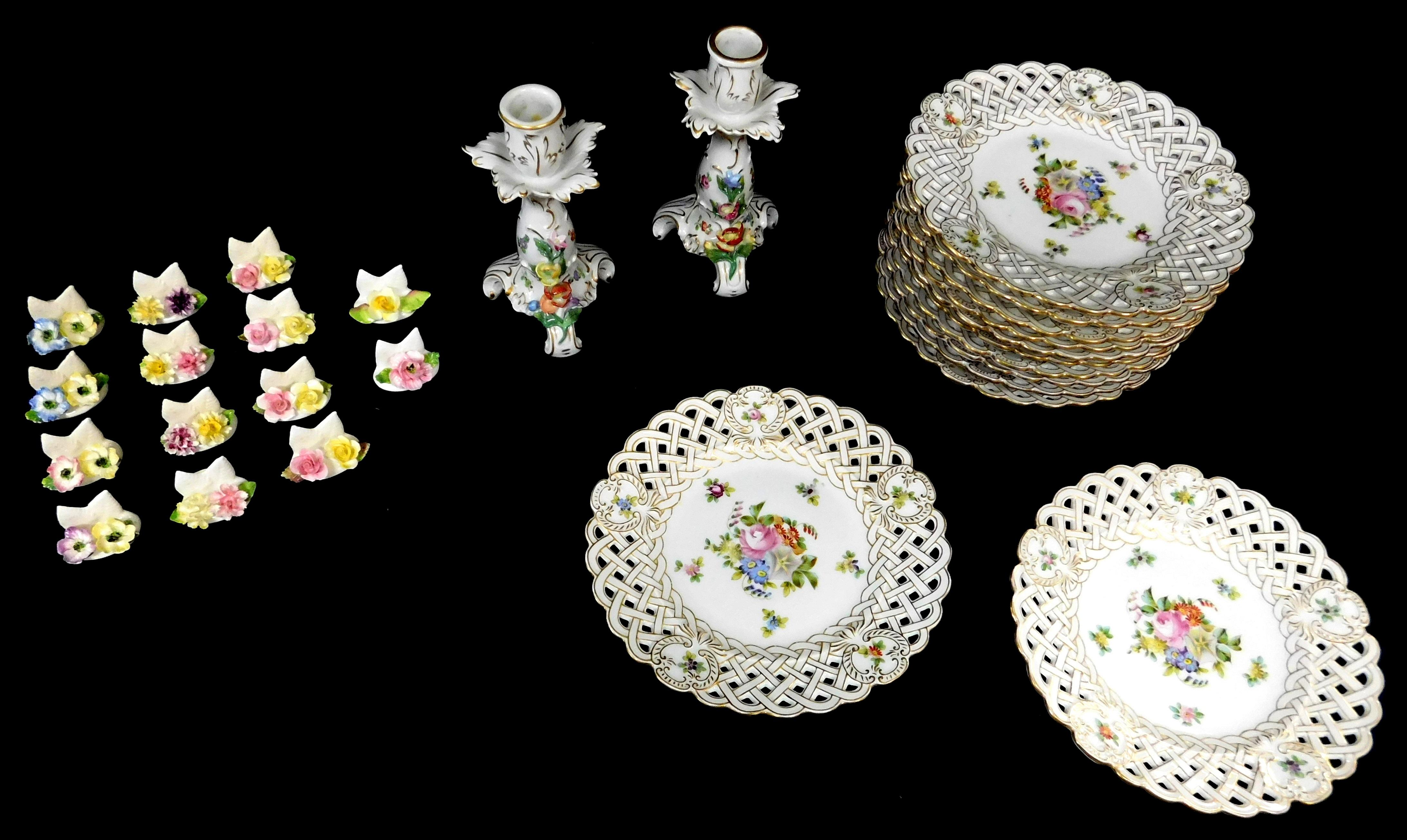 """Gilt and floral decorated porcelain group, including: twelve Richard Briggs reticulated rim dessert plates, 8"""" diam.; along with pai..."""