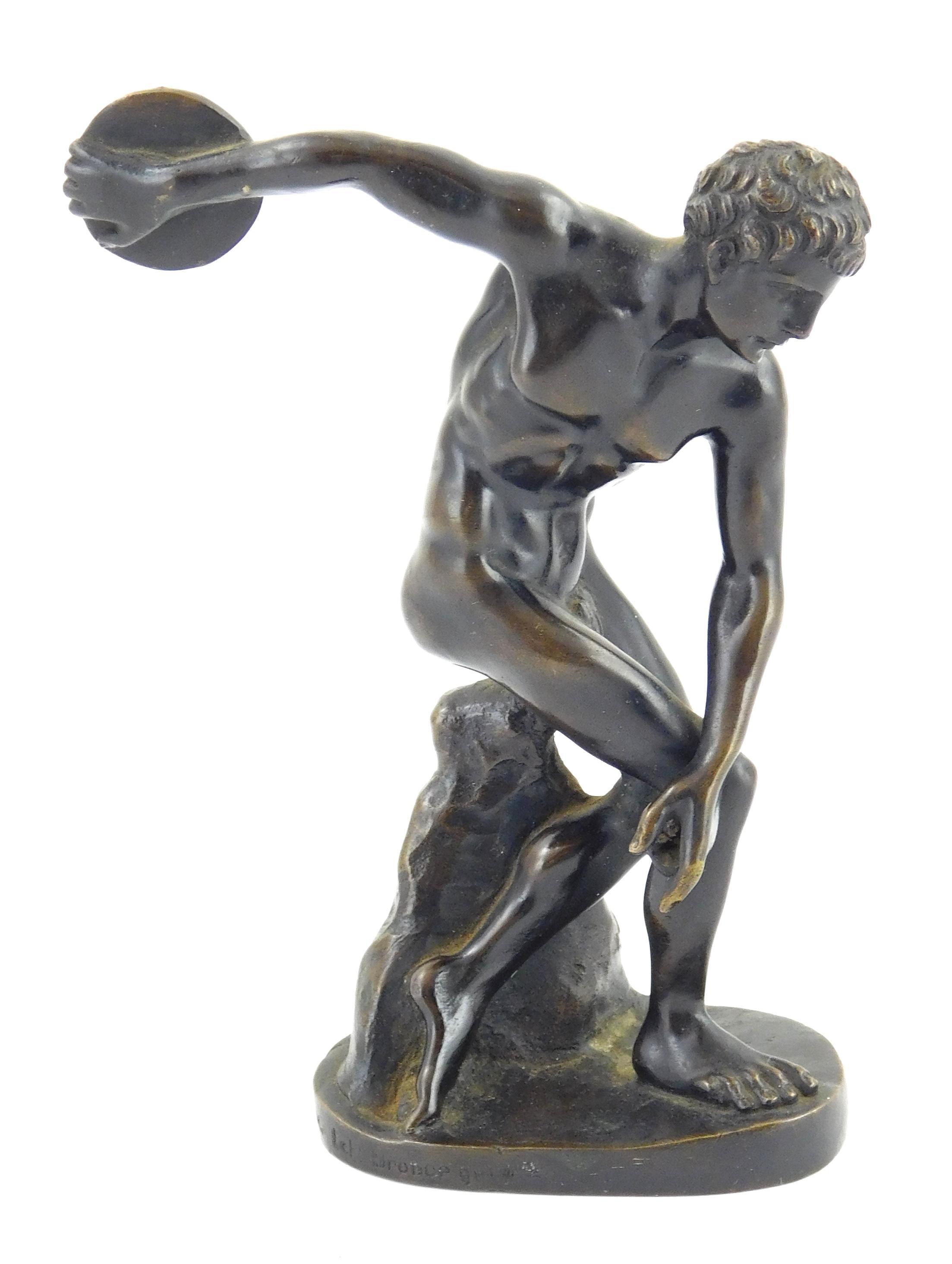 "Bronze discus thrower signed ""Oskar Gladenbeck/ G.m.b.H/ Lct./ Bronce/ garant"" along edge of base, depicts nude male athlete crouchi..."