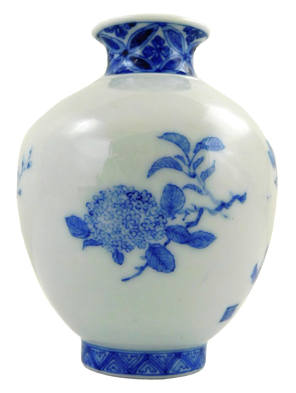 ASIAN: Japanese porcelain, 20th C., including: vase with blue and white floral decoration, signed, four section cylindrical stacking...