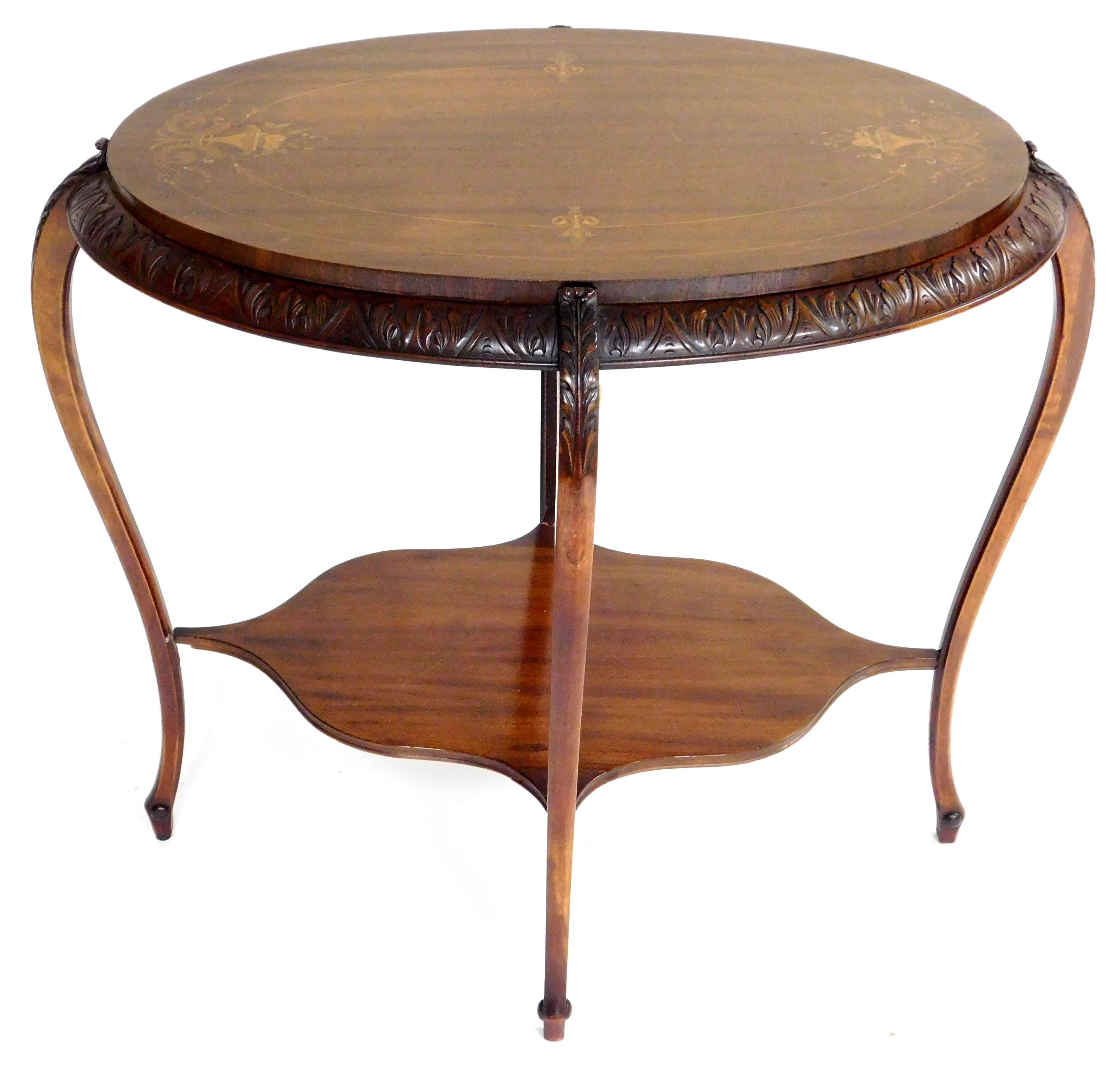 Oval table with marquetry and mother of pearl inlaid accents, early 20th C., some floral basket veneers with coloring, carved acanth...