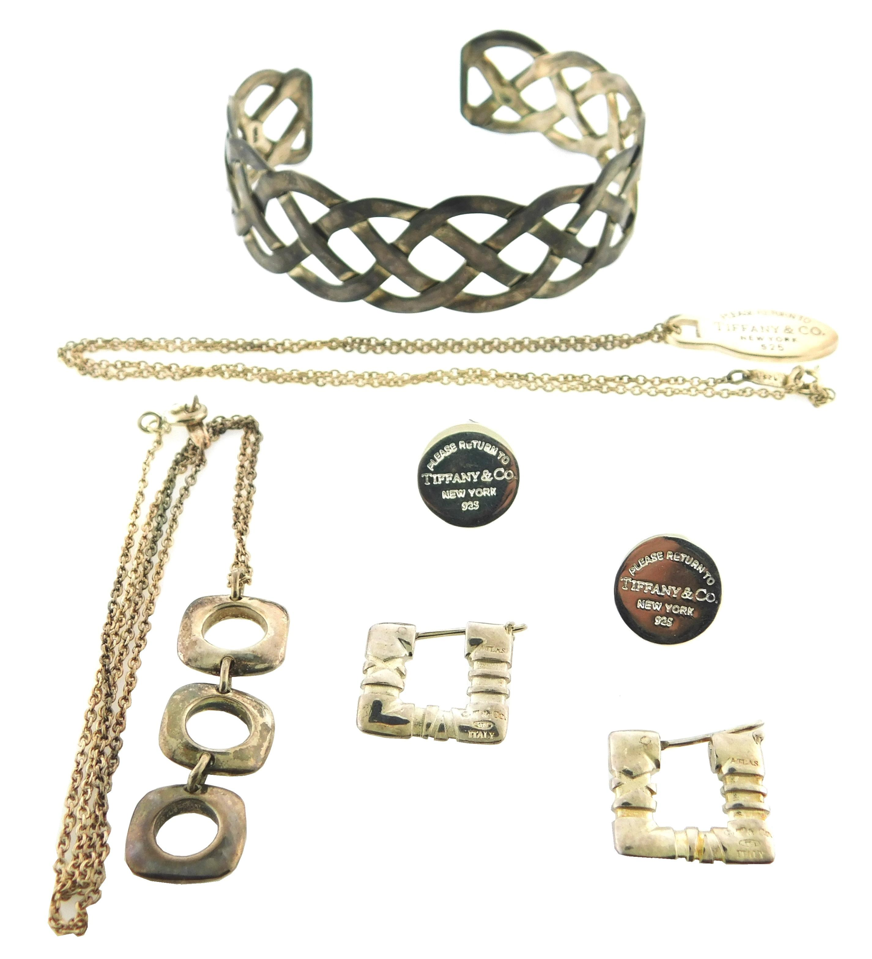 SILVER: Four sterling Tiffany & Co. jewelry pieces and one pierced sterling cuff, all pieces marked, details include: two Tiffany pe...