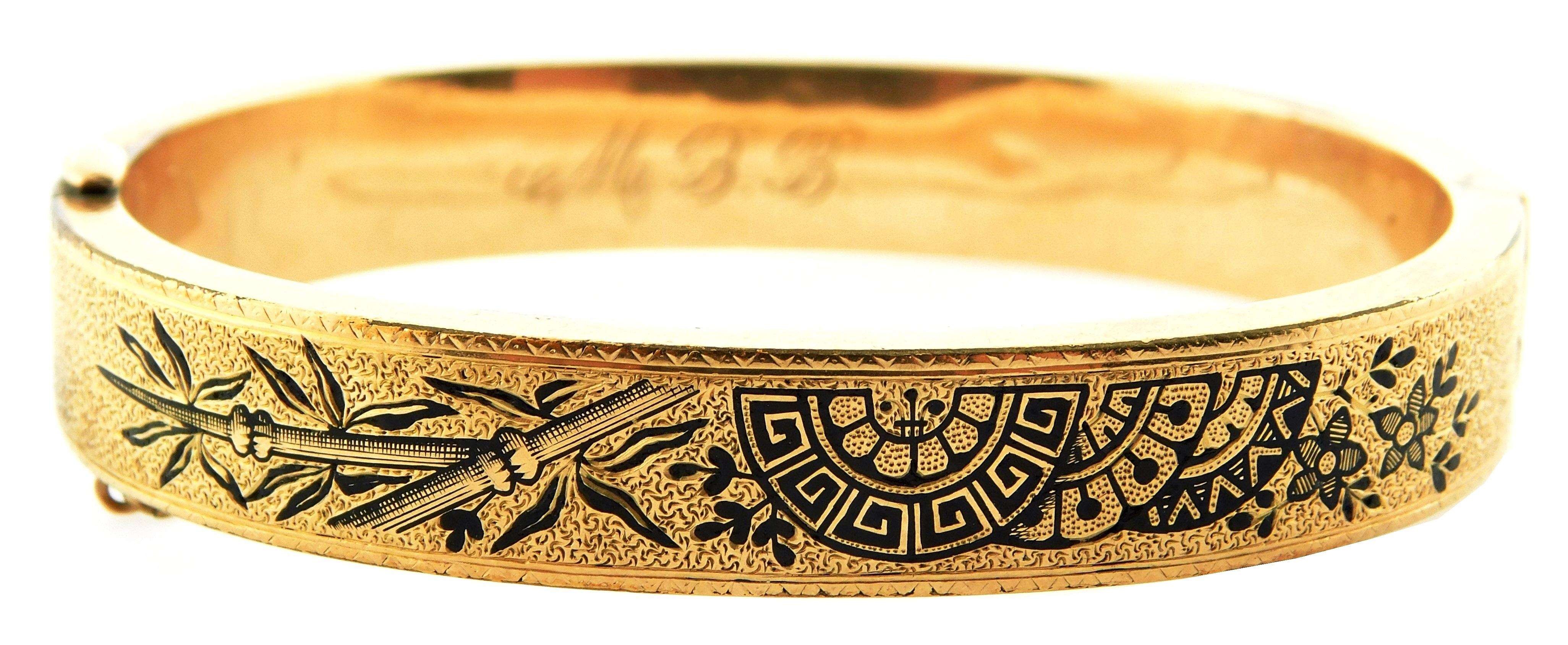 JEWELRY: 14K Victorian hinged bangle bracelet with safety chain: tested 14K yellow gold with engraved and black enamel design, width...