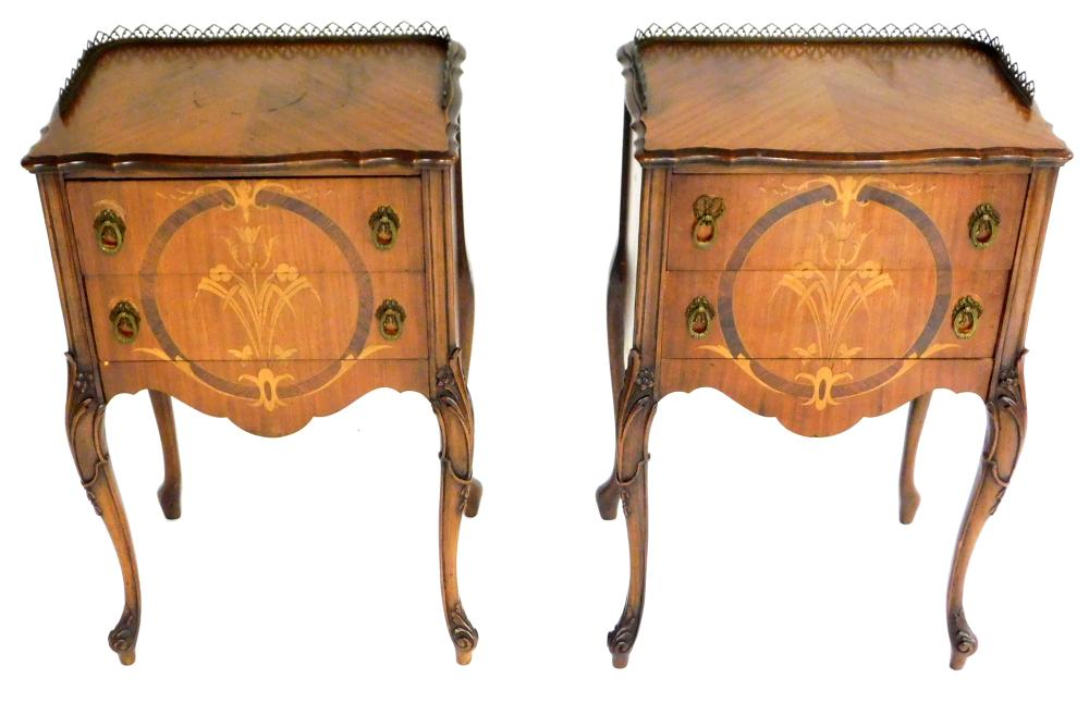 Pair of Continental two drawer stands with marquetry, 20th C., mahogany and mahogany veneer, shaped top with three-quarter brass gal...
