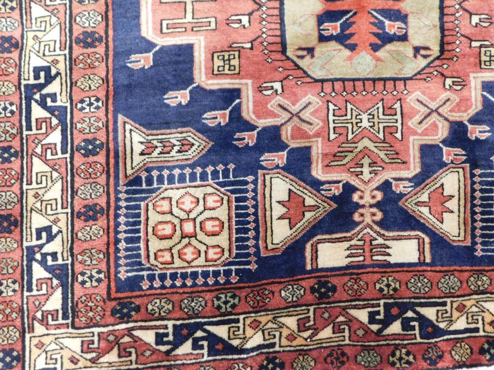 "RUG: Semi-Antique Azerbaijan Caucasian, 4' 3"" x 9' 2"", dark navy field, three angular stepped medallions of cinnabar and camel, ensc."